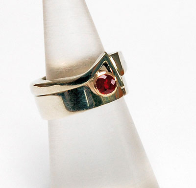 White Gold and Ruby Engagement Ring with fitted Wedding Ring Set
