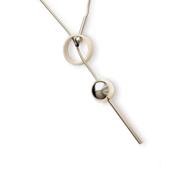 Omni Pendant Lariat Necklace isBall and Rind Necklace. A contemporary lariat style necklace. The front fastening mechanism makes it so easy to wear and creates the unique design feature of a circle with an 18mm ball balancing on a Tube at the front. this necklace is approx. 60cm long