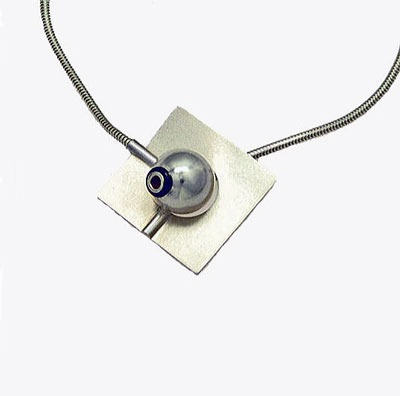 this Omni Silver Disc and Ball Pendant is a unique contemporary necklace which features contrasting textures for a stricking focal point to any outfit.