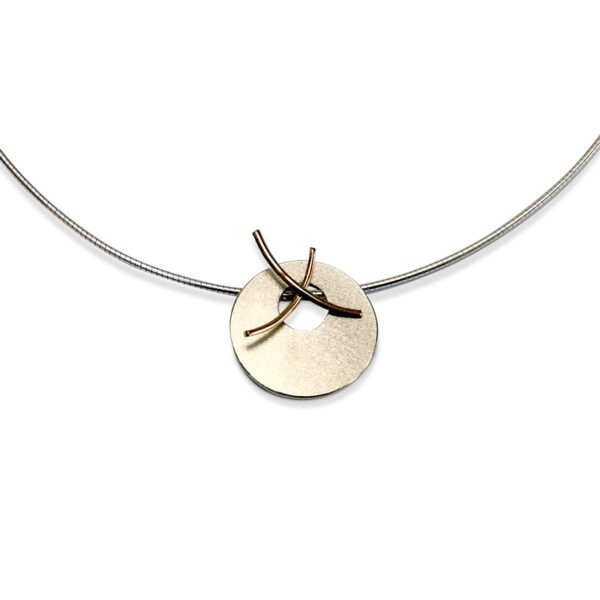 DISC NECKLACE Designer Jewellery. This unique disc necklace comprises a 2cm silver disc which is suspended on a curved gold line. This allows the wearer to select whether to wear the line curving up or curving down. The designer jewellery pendant can either have a 16 or 18 inch silver omega necklace.