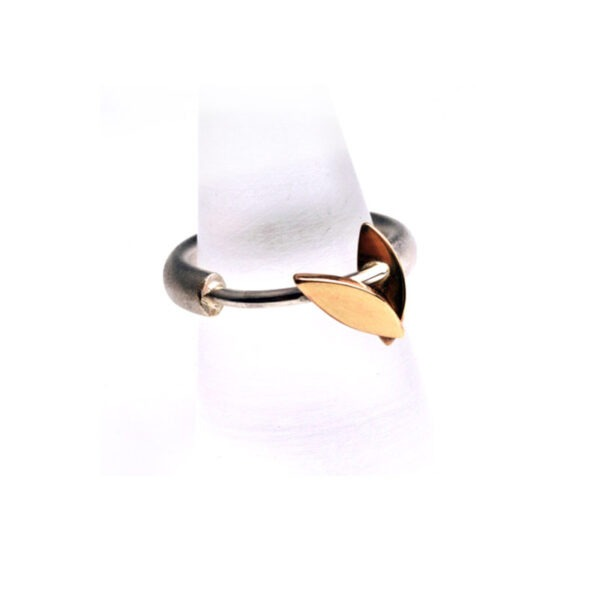 Silver ring band with 9ct gold marquis shaped design feature.