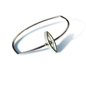 Designer silver and gold kinetic bangle. The marquis shape with  gold rondelle rotates on the main bangle. The bangle is made from silver wire which has a diameter of 2mm