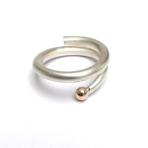Designer, Contemporary spiral ring with 9ct gold ball. This contemporary finger ring is satinized with a polished 9ct gold ball.