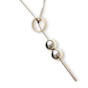 Ball and Rind Necklace. A contemporary lariat style necklace. The  front fastening mechanism makes it so easy to wear and creates the unique design feature of a circle with an 18mm ball balancing on a Tube at the front. this necklace is approx. 60cm long