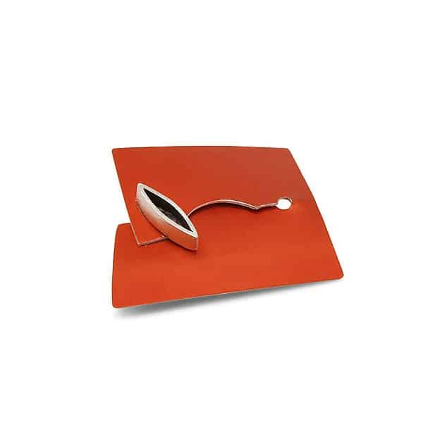 Aluminium brooch in burnt orange with oxidised silver marquis decoration