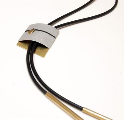 Aluminium, brass and rubber designer necklace by contemporary jewellery designer Helen Swan. Scottish designer jewellery, Glasgow