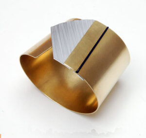 Brass-and-Aluminium Designer-Bangle by Scottish Jewellery Designer Helen Swan whose studio can be found in Glasgow scotland UK