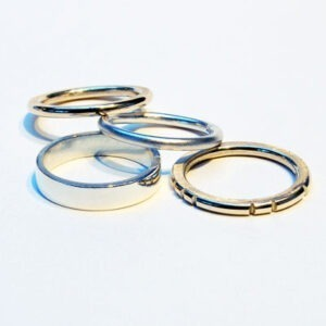 Wedding bands or stacking rings. This designer silver and gold ring-stackcan be worn as a group, individually or in different combinations of two or three. The styles show possible wedding band options and each can be made in silver, yellow gold, white gold in 9ct or 18ct The prices are available on request, please get in touch