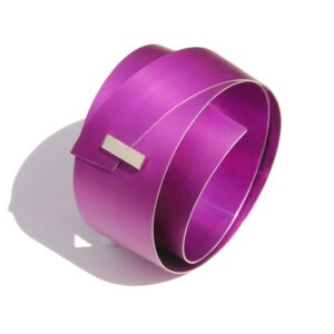 large, mauve aluminium bangle with rectangular silver detail at the front