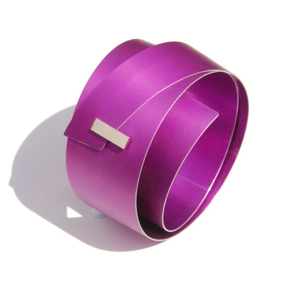 large, mauve anodised aluminium bar bangle with rectangular silver detail at the front