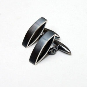 The Oxidised designer cufflinks are two marquis shaped on their side with a bullet shaped cufflink attachment