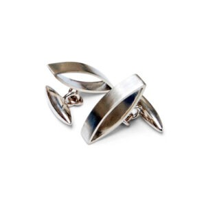 the designer cufflinks are two marquis shaped on their side with a bullet shaped cufflink attachment