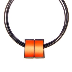 Viola Aluminium Pendant Cable Necklace featured is an orange aluminium pendant suspened on a rubber cable choker necklace