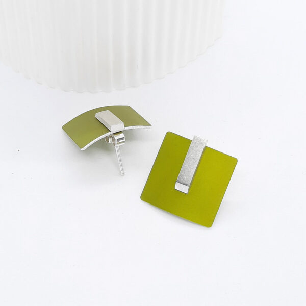 Another earring design from my versatile Three-in-One designer earring range. An anodised aluminium and silver combination . Three different options from one design. Other colours are available