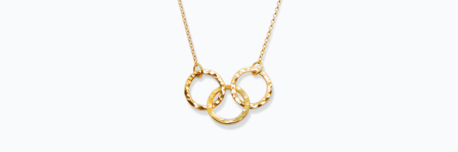 a bespoke necklace featuring 3 textured gold hoops to illustrate 3 interesting facts about gold by contemporary jewellery designer Helen Swan