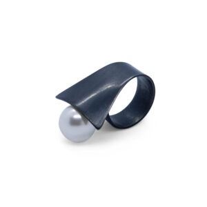 Oxidised  ring with a large shell pearl. This Statement ring will get you noticed. It slips onto your finger and the pearl leans over and rests on your adjacent finger. As I said the pearl is a shell pearl and contrasts beautifully with the with oxidised silver.