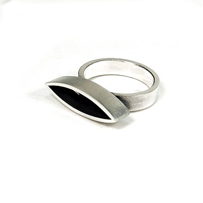 This simple stylish designer ring will compliment many other pieces within my Marquis collection. It's stamped 925.