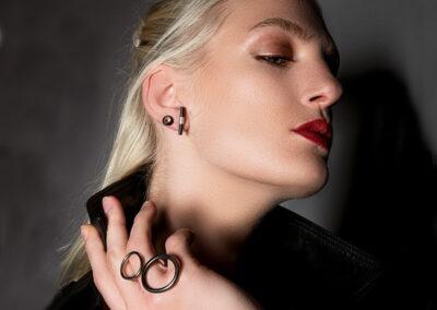 Model Wearing Helen Swan Rings and Earrings