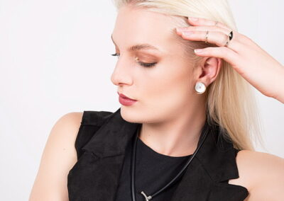 Model Wearing Helen Swan Necklace and Earrings on a white background