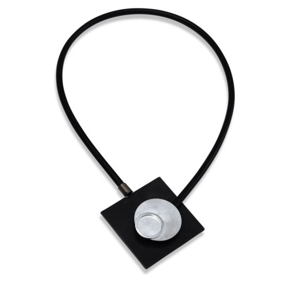 Rubber, Steel with silver disc. Front fastening magnetic designer necklace