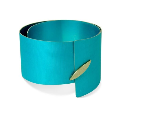 large, turquoise aluminium bangle with marquis shaped silver detail at the front