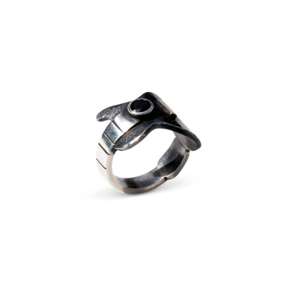 Guitar Ring with a black sapphire. The features of this ring are enhanced with the contrast the between oxidised and shiny metal.