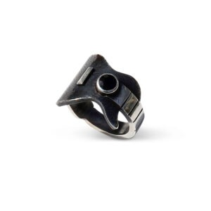 Guitar Ring with a black sapphire. The features of this ring are enhanced with the contrast the between oxidised and shiny metal