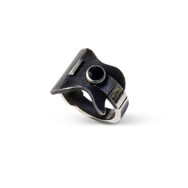 Musicians Guitar Ring with a black sapphire. The features of this ring are enhanced with the contrast the between oxidised and shiny metal