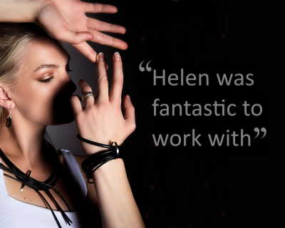 A women is shown modelling contemporary rubber jewellery by designer Helen Swan next to a testimonial of her work