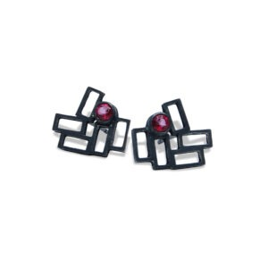 Cluster Earring Studs. Designer stud earrings The earrings have a facetted garnet in the cluster of rectangles. They are black oxidised metal