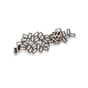 Cluster Tangle Brooch featuring intricate rectangles oxidised black set on a black bar brooch